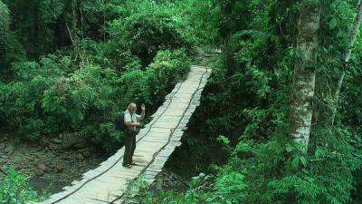 Lars Andersen on small suspension bridge, Caranavi, Yungas. d. 27 january 2010. Photographer: Peter M�llmann